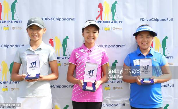 Claire Chang Michelle Woo and Anna Jiaxin Huang pose for a photo after finishing in the top three overall in the girls 1011 competition during The...
