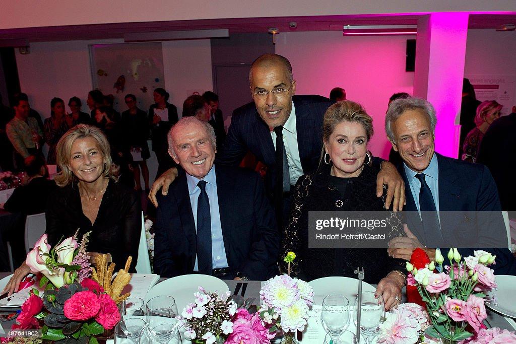 Claire Chazal, Francois Pinault, Kamel Menour, Catherine Deneuve and Francois de Ricqles attend the Auction Dinner to Benefit 'Institiut Imagine' on September 10, 2015 in Paris, France.