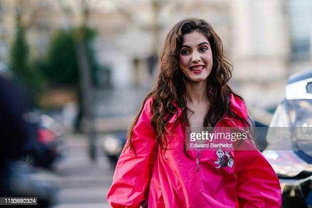 Claire Chust wears a pink dress outside Shiatzy Chen during Paris Fashion Week Womenswear Fall/Winter 2019/2020 on March 04 2019 in Paris France