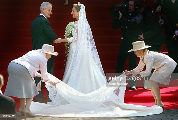 Claire Coombs greets her father Nicholas Coombs at the bottom of the stairs of the Cathedral of St Michael and St Gudula before her marriage ceremony...