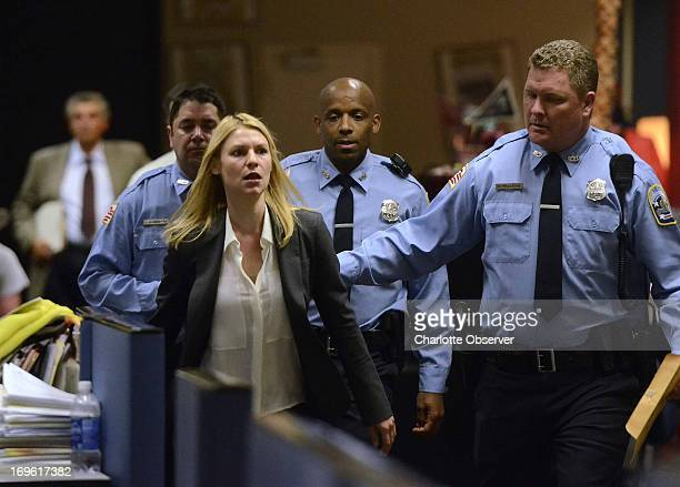 Claire Danes acts in a scene as Showtime brings the production of Homeland to the newsroom floor of the Charlotte Observer May 28 2013 in Charlotte...