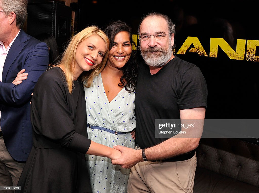 Claire Danes, Sarita Choudhury and Mandy Patinkin attend a Private Reception And Screening Of Homeland Season 4 on September 4, 2014 in New York City.