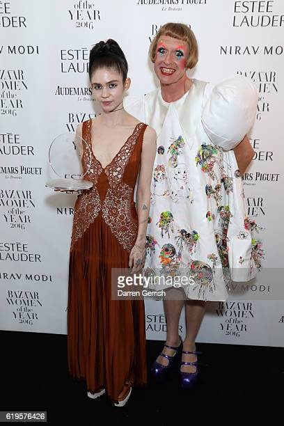 Claire Elise Boucher AKA Grimes and Grayson Perry attend Audemars Piguet Sponsor Of The Harper's Bazarre Women Of The Year Awards 2016 at Claridges...