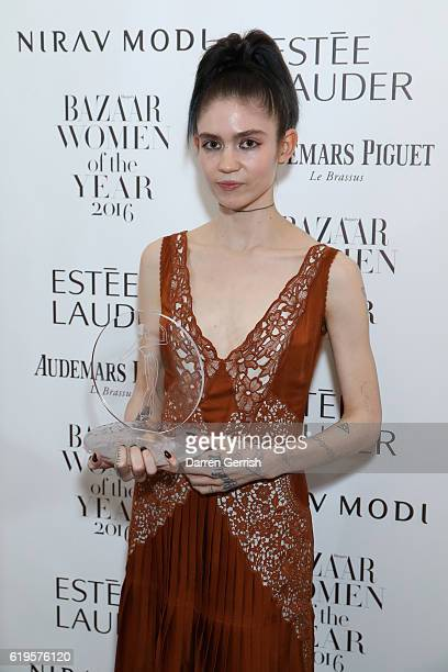 Claire Elise Boucher AKA Grimes attends Audemars Piguet Sponsor Of The Harper's Bazarre Women Of The Year Awards 2016 at Claridges Hotel on October...