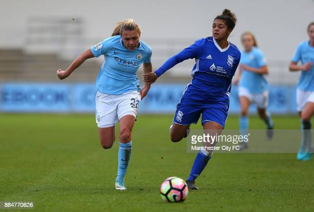 Claire Emsley of Manchester City Women battles with Jess Carter of Birmingham City Ladies during the FA WSL Continental Tyres Cup between Manchester...