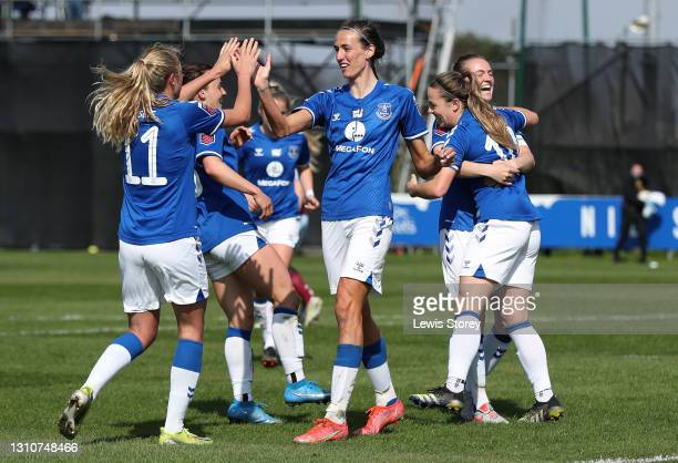 Claire Emslie and Jill Scott of Everton celebrate their side's third goal scored by team mate Simone Magill during the Barclays FA Women's Super...