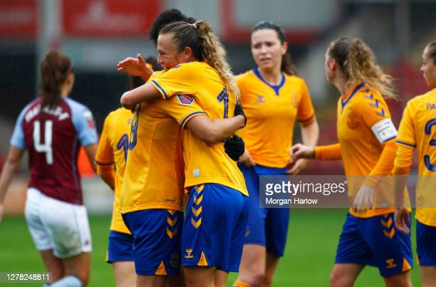 Claire Emslie of Everton celebrates with her team mates after scoring her team's third goal during the Barclays FA Women's Super League match between...