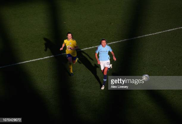 Claire Emslie of Manchester City Women chases the ball with Harriet Scott of Birmingham City Women during the FA WSL match between Manchester City...