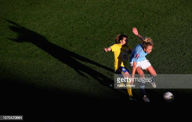 Claire Emslie of Manchester City Women holds off a challenge from Harriet Scott of Birmingham City Women during the FA WSL match between Manchester...