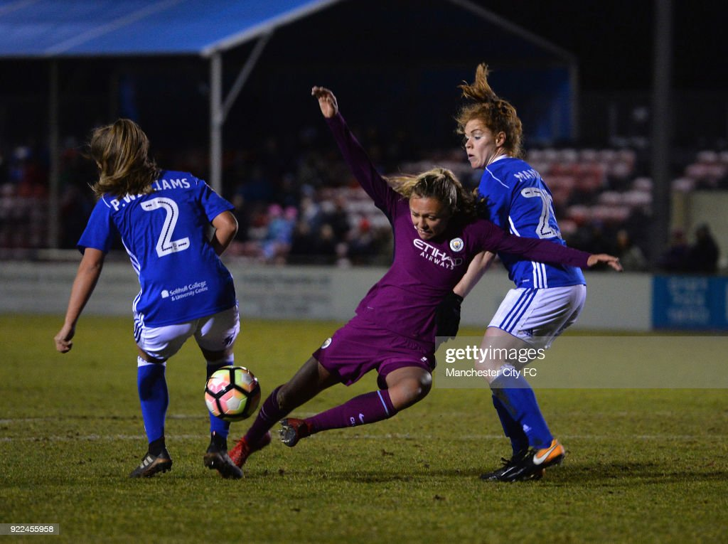 Claire Emslie of Manchester City Women is tackled by Aoife Mannon and Paige Williams of Birmingham City Ladies during the WSL match between Birmingham City Ladies and Manchester City Women at Damson Park on February 21, 2018 in Solihull, England.