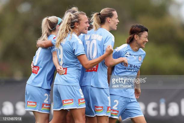 Claire Emslie of Melbourne City celebrates with teammates after scoring her team's first goal during the W-League Semi Final match between Melbourne...