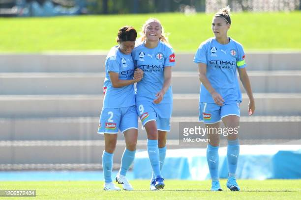 Claire Emslie of Melbourne City is congratulated by Yukari Kinga of Melbourne City after scoring a goal during the round 12 W-League match between...