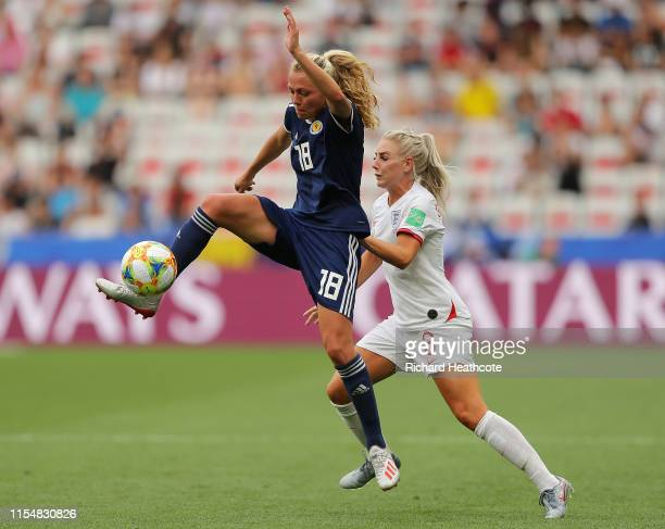 Claire Emslie of Scotland battles for possession with Alex Greenwood of England during the 2019 FIFA Women's World Cup France group D match between...
