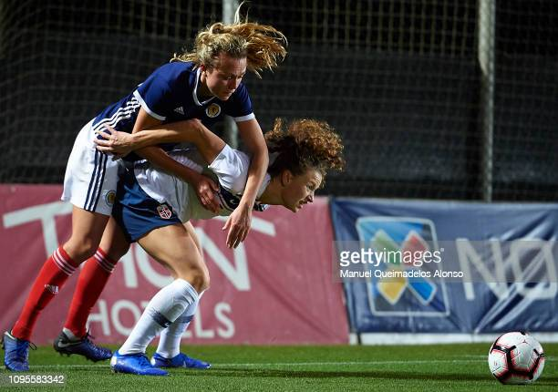 Claire Emslie of Scotland competes for the ball with Synne Skinnes of Norway during the Women's International Friendly match between Scotland and...