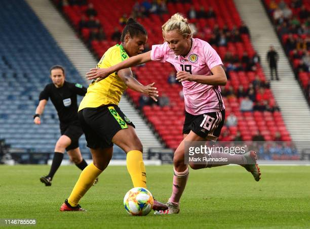 Claire Emslie of Scotland takes on Dominique BondFlasza of Jamaica during the Women's International Friendly between Scotland and Jamaica at Hampden...