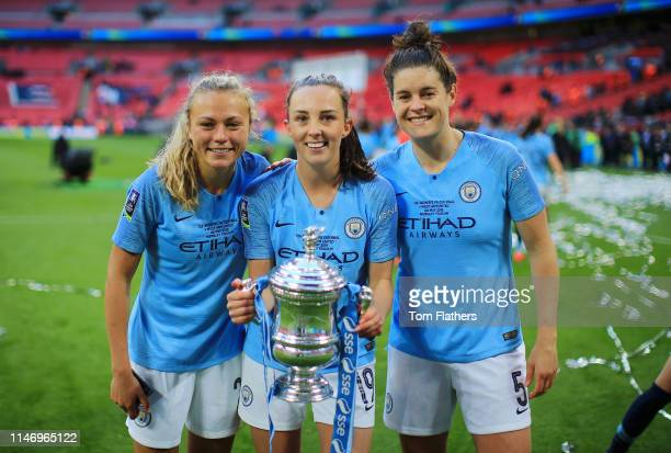 Claire Emsliel Caroline Weir and Jennifer Beattie of Manchester City Women pose for a photo with the Women's FA Cup Trophy following their victory in...