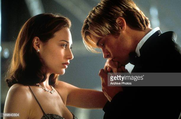 Claire Forlani has her hand kissed by Brad Pitt in a scene from the film 'Meet Joe Black' 1998