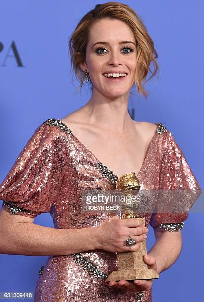 Claire Foy poses with the Best Actress in a Drama TV series award for her role in The Crown in the press room at the 74th annual Golden Globe Awards...