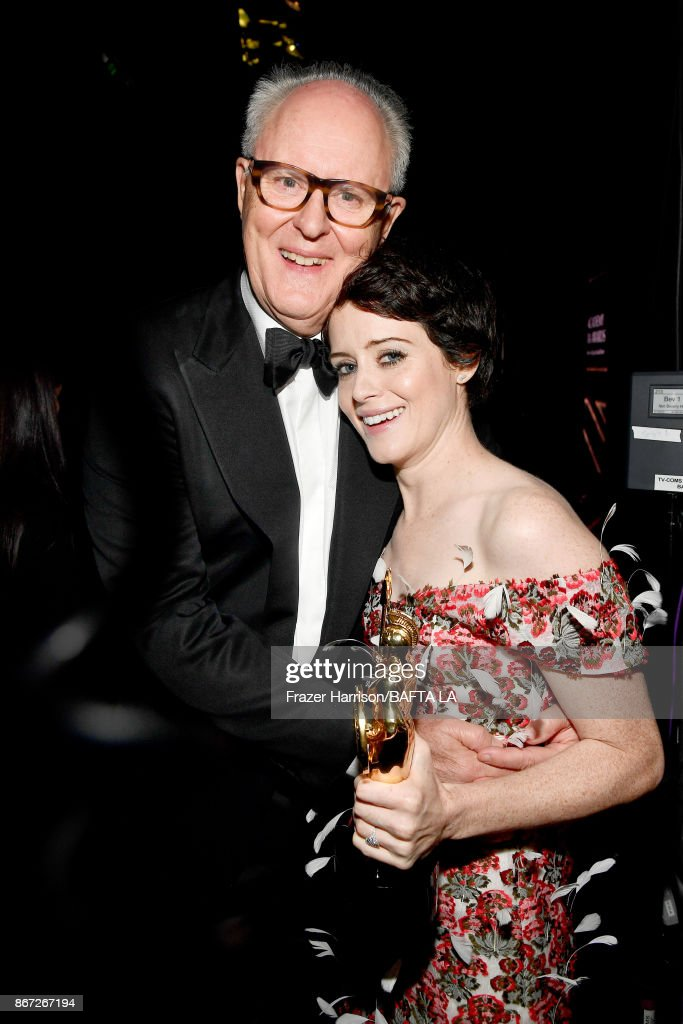 Claire Foy (R), recipient of the Britannia Award for British Artist of the Year presented by Burberry, with John Lithgow at the 2017 AMD British Academy Britannia Awards Presented by American Airlines And Jaguar Land Rover at The Beverly Hilton Hotel on October 27, 2017 in Beverly Hills, California.