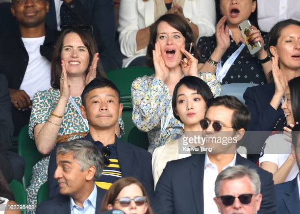 Claire Foy Yusaku Maezawa and Ayame Goriki on Centre Court on Men's Finals Day of the Wimbledon Tennis Championships at All England Lawn Tennis and...
