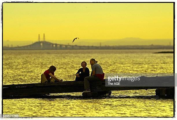 Claire Grady Natalie Konemann and Jo Joyce photographed enjoying Melbourne's balmy June weather on the boat ramp at Elwood Beach 7 June 2005 THE AGE...