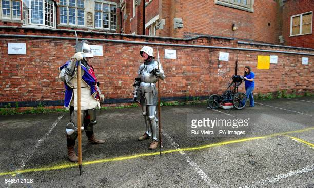 Claire Graham uses ground penetration radar at Greyfriars car park in Leicester watched by actors dressed as Knights from Historic Equitation Ltd...