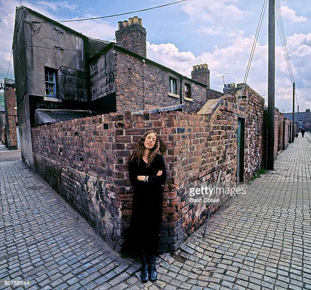 Claire Hamill posed behind terraced houses on May 29 1971 in Skinningrove, North Yorkshire