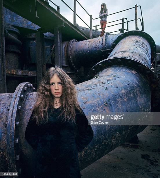 Claire Hamill posed with industrial pipes from the steelworks at Skinningrove, North Yorkshire on May 29th 1971.