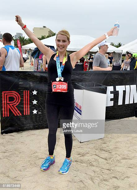 Claire Holt arrives at the finish line at Life Time South Beach Triathlon swim at Lummus Park on April 3 2016 in Miami Beach Florida