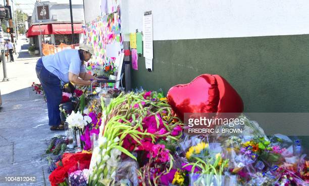 Claire Houston leaves flowers at a memorial for Melyda Corado the assistant manager at the Silver Lake Trader Joe's who was killed in a July 21...