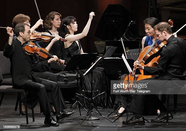 Claire Huangci of the USA performs during the Van Cliburn International Piano Competition with the Bertano String Quartet at Bass Performance Hall in...