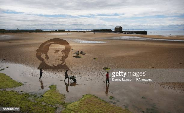 Claire Jamieson Tom Bolland and Jamie Wardley from sand sculpture company Sand in Your Eye creates a sculpture of Franz Schubert on Elie Beach in...