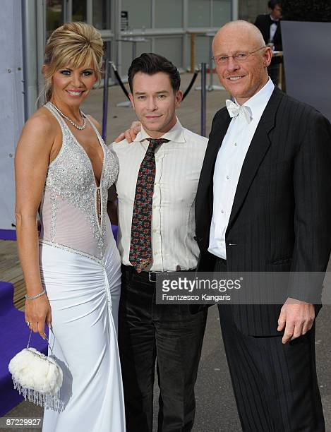 Claire Johnson Stephen Gately and John Caudwell arrive at The Caudwell Children Butterfly Ball at Battersea Evolution on May 14 2009 in London England
