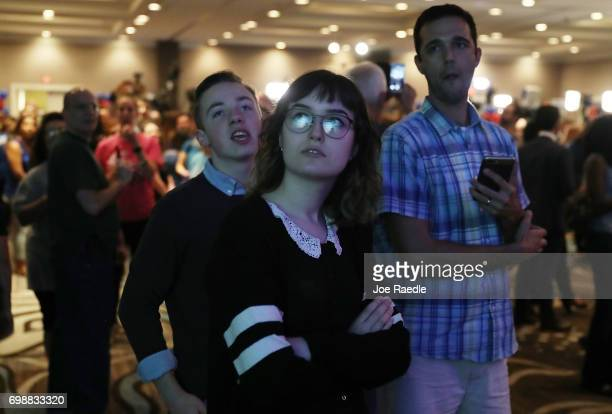 Claire Kiely and others watch election results come in on a television screen setup at the election party for Democratic candidate Jon Ossoff being...