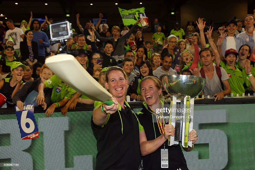 Claire Koski (L) and Alex Blackwell of the Thunder take a selfie with the tropy following the Big Bash League final match between Melbourne Stars and the Sydney Thunder at Melbourne Cricket Ground on January 24, 2016 in Melbourne, Australia.