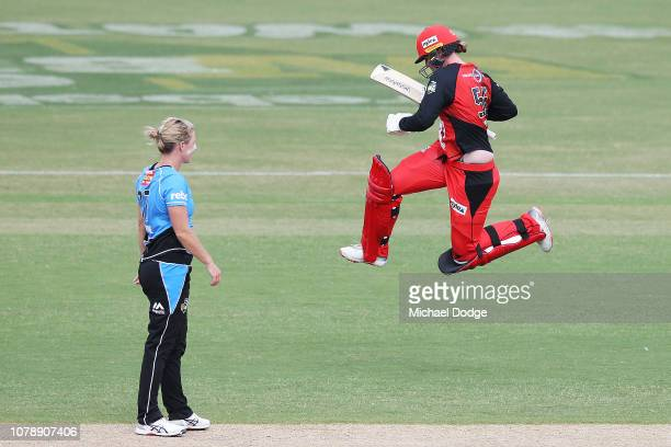 Claire Koski of the Renegades celebrates after hitting the winning runs off the bowling of Sophie Devine of the Strikers during the Women's Big Bash...