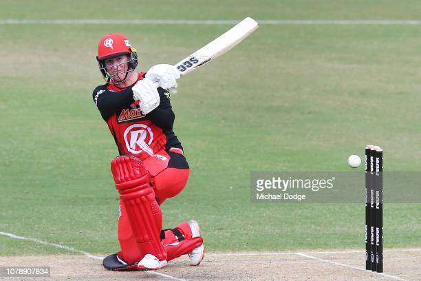 Claire Koski of the Renegades hits the winning runs off the bowling of Sophie Devine of the Strikers during the Women's Big Bash League match between...