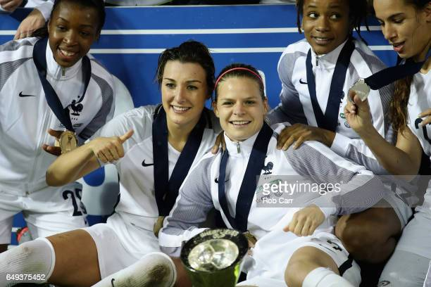Claire Lavogez and Eugenie Le Sommer of France celebrate after France defeated the United States 30 to win the 2017 SheBelieves Cup at RFK Stadium on...
