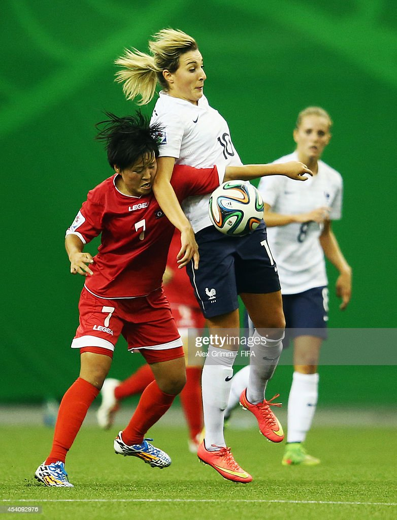 Claire Lavogez (R) of France is challenged by Choe Yun Gyong of Korea DPR during the FIFA U-20 Women's World Cup Canada 2014 3rd place match between Korea DPR and France at Olympic Stadium on August 24, 2014 in Montreal, Canada.