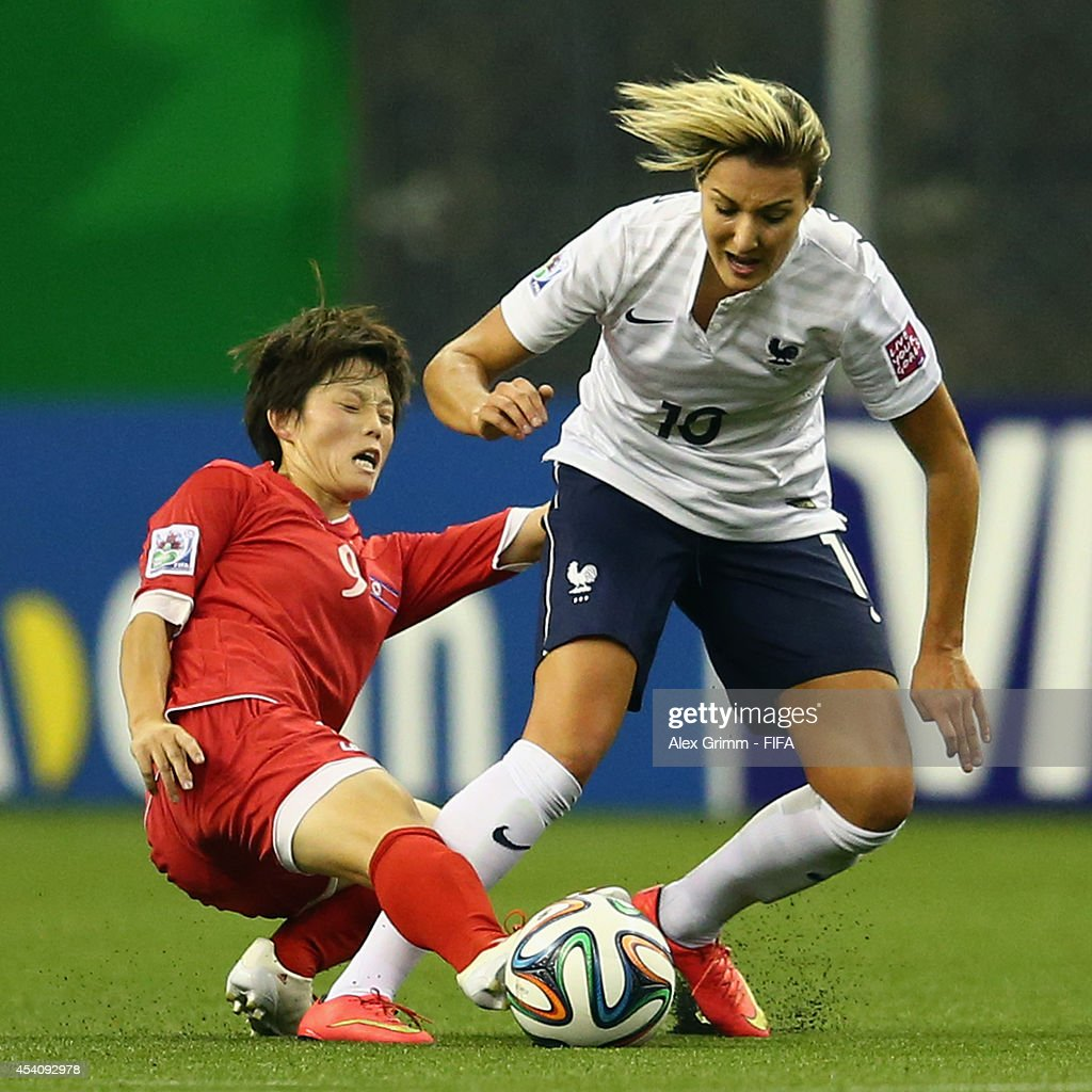 Claire Lavogez (R) of France is challenged by Ri Hyang Sim of Korea DPR during the FIFA U-20 Women's World Cup Canada 2014 3rd place match between Korea DPR and France at Olympic Stadium on August 24, 2014 in Montreal, Canada.