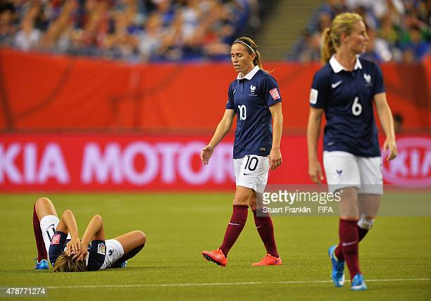 Claire Lavogez of France lays dejected on the pitch during the quarter final match of the FIFA Women's World Cup between Germany and France at...
