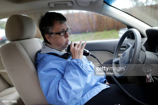 Claire LeBlanc is photographed with an ignition interlock device that is connected to her car in Chatham MA on May 6 2017 After several DUIs she is...
