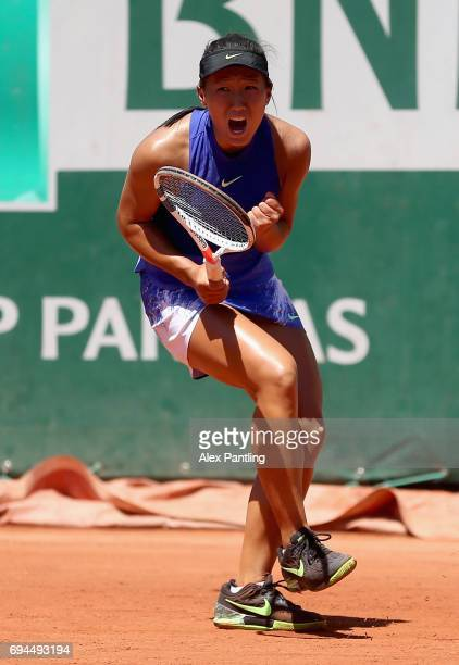 Claire Liu of The United States celebrates a point during the girls singles final match against Whitney Osuigwe of The United States on day fourteen...
