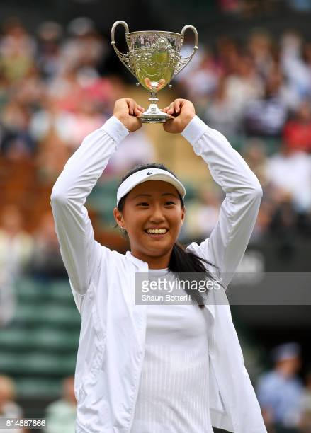 Claire Liu of the United States celebrates victory with the trophy after the Girl's Singles final match against Ann Li of the United States on day...