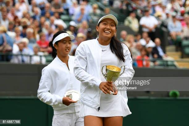 Claire Liu of the United States celebrates victory with the trophy alongside runnerup Ann Li of the United States after the Girl's Singles final...
