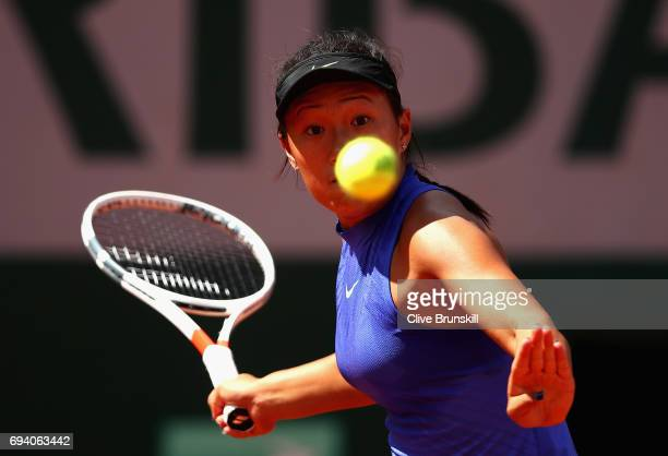 Claire Liu of The United States plays a backhand during girls singles semifinal match against Marta Paigina of Russia on day thirteen of the 2017...