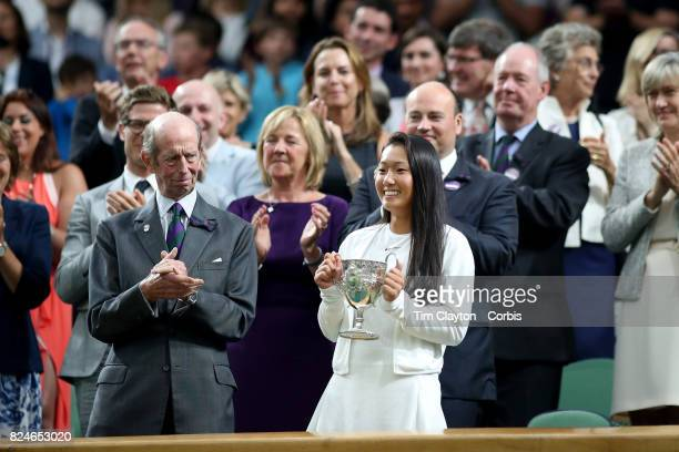 Claire Liu of the United States with her trophy after winning the Girls' Junior Singles title during the Wimbledon Lawn Tennis Championships at the...