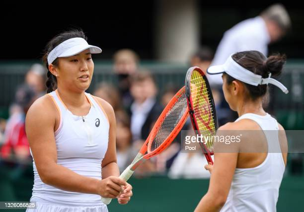 Claire Liu of United States touches rackets with Misaki Doi of Japan after the Ladies' Singles First Round match during Day Two of The Championships...