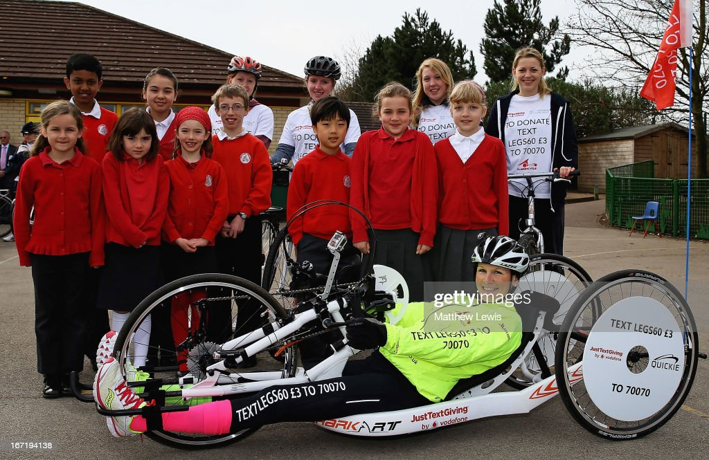 Claire Lomas poses with children from Greythorne Primary School on April 22, 2013 in Nottingham, England. Claire Lomas is set to hand-cycle 400 miles over three weeks from Nottingham to London to raise money for Spinal research and the Nicholls Foundation through her JustTextGiving by Vodafone code LEGS60. Anyone wishing to donate can text LEGS60 £3 to 70070.