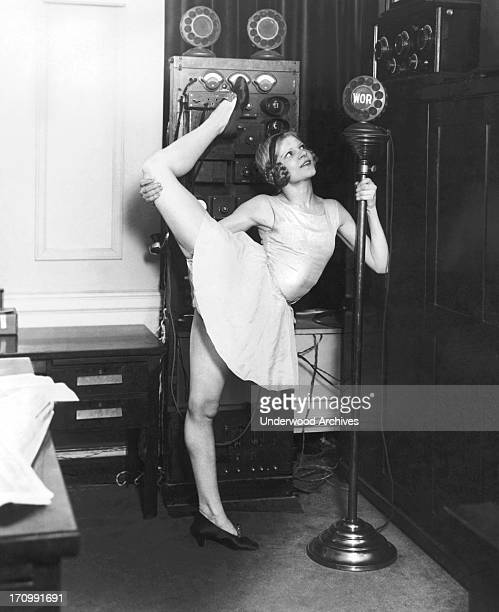 Claire Luce star dancer of the Music Box Revue is one of the early birds in the WOR radio gym class New York New York April 24 1925